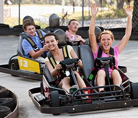 Two girls in a double go-kart at SpeedZone Fun Park