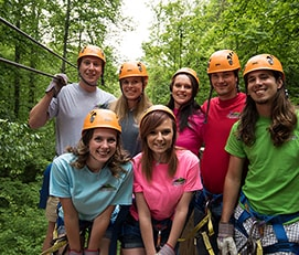 Group of young people with helmets at Legacy Mountain Ziplines