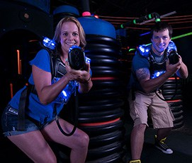Two adults laser tagging at LazerPort Fun Center