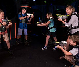 Group of kids laser tagging at LazerPort Fun Center