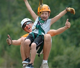 Guide and child tandem ziplining